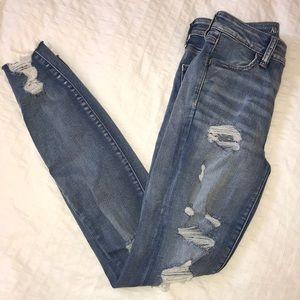 AMERICAN EAGLE: distressed super stretch x jeans